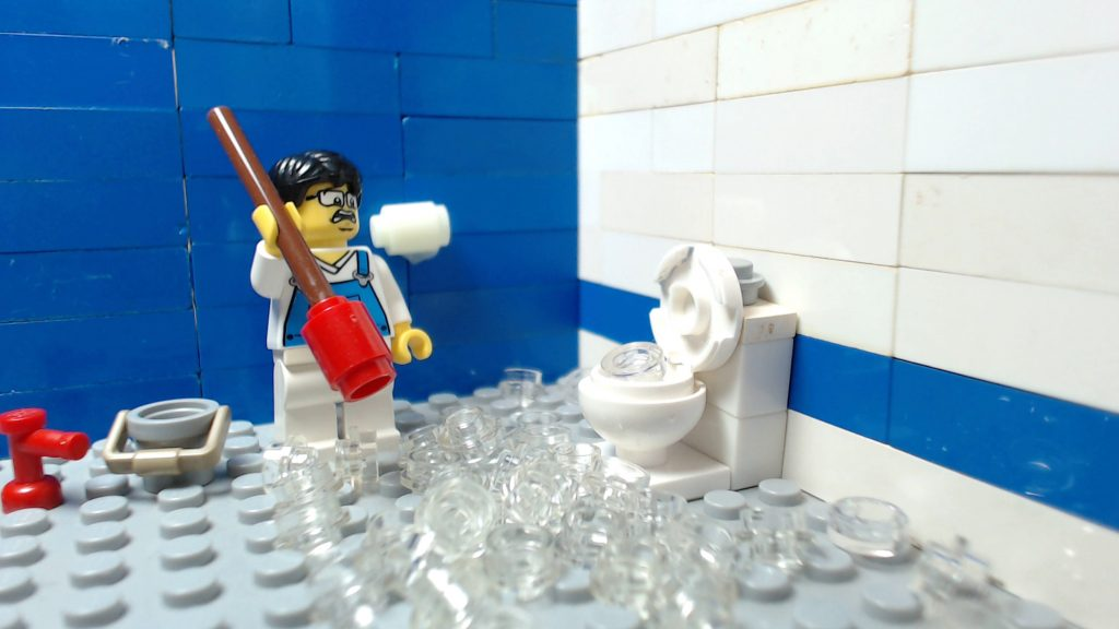 image showing a LEGO character removing thousands of condoms from a blocked toilet