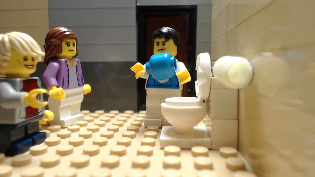 image showing a LEGO plumber removing an unpopped water balloon from a toilet